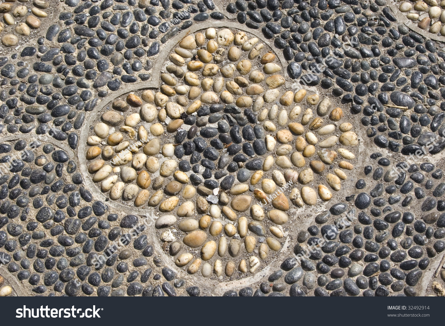 Flower pattern pebbles hard surface paving stock photo for Hard surface garden designs