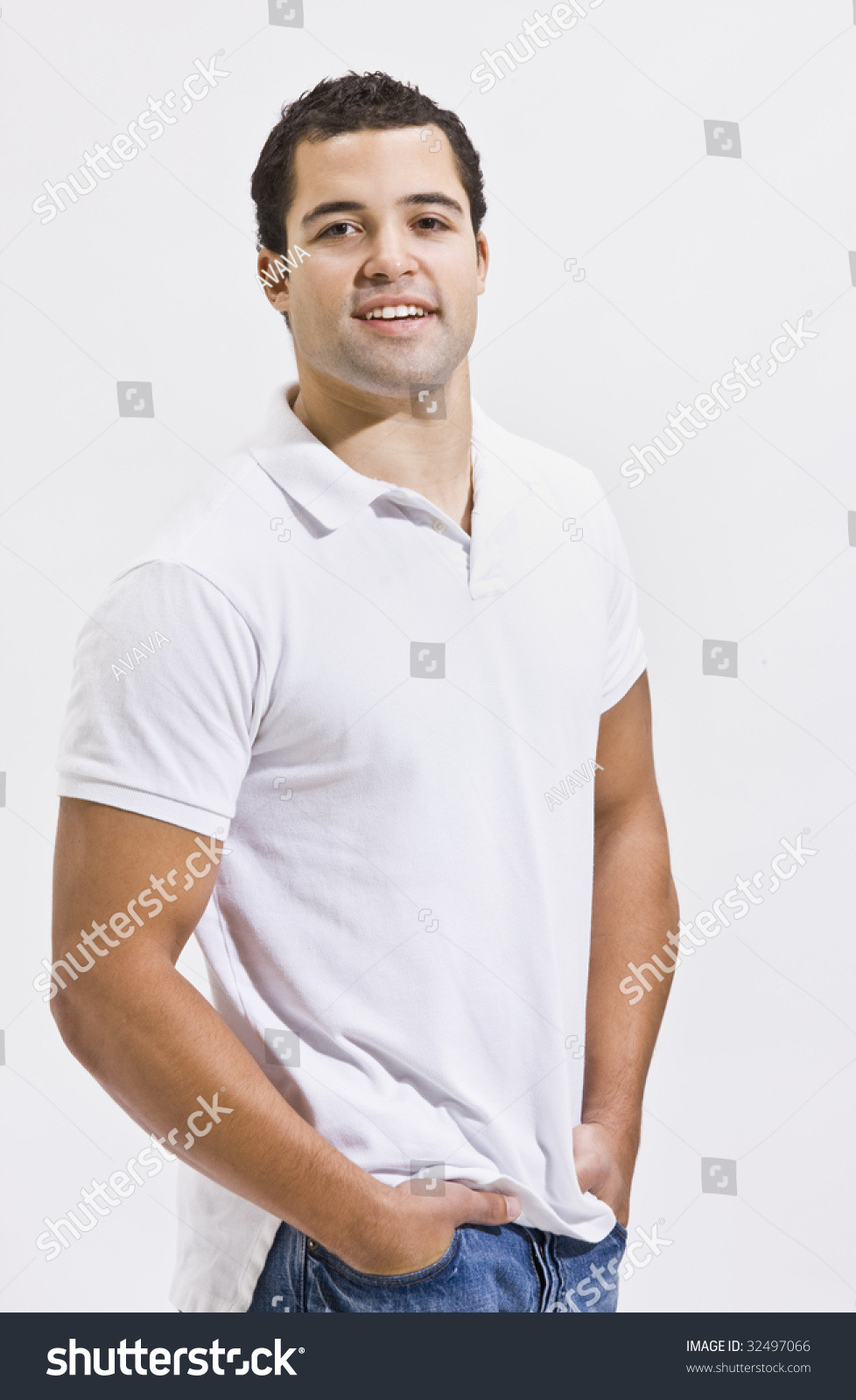 White t shirt blue jeans - An Attractive Man Posing In Blue Jeans And A Polo Shirt He Is Smiling Directly