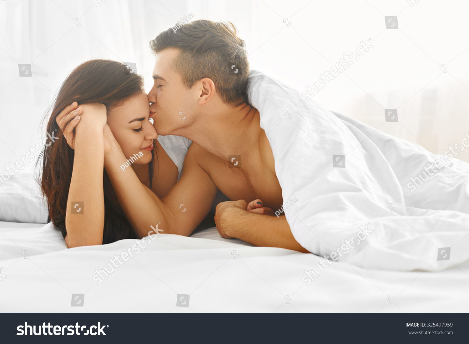 Lovely Couple In Bed Lying In Bedroom Young Lovely Tender Couple Enjoying Morning Lying In Bed In Their