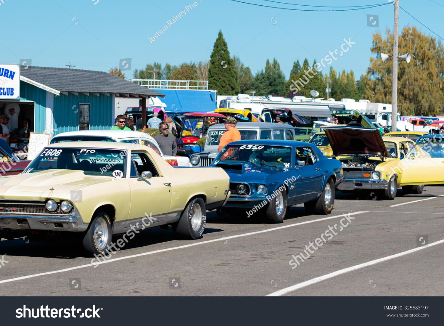 WOODBURN, OR - SEPTEMBER 27, 2015: Classic cars line up to race in