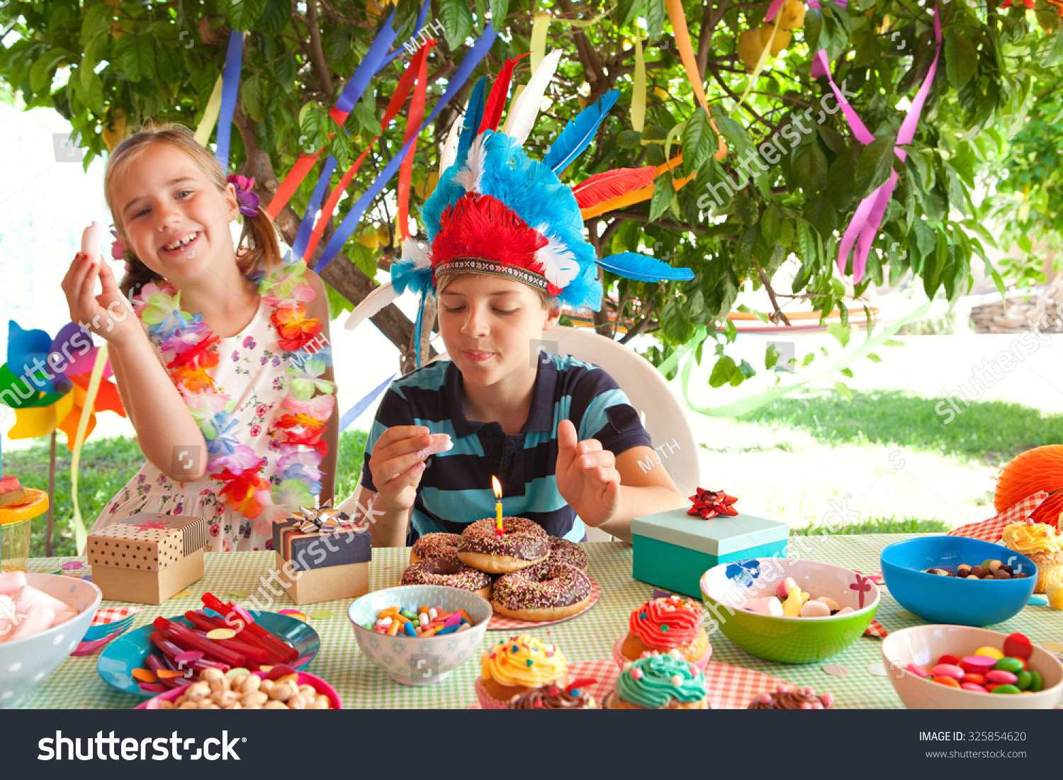 Portrait of children dressing up in fancy dresses at a Home and garden party
