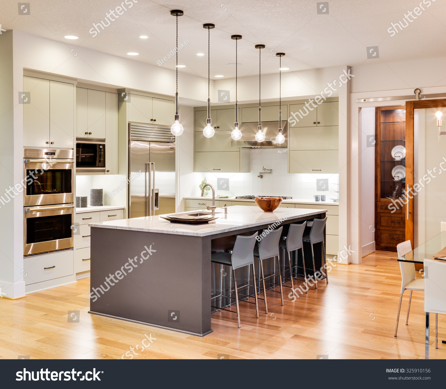 Kitchen Island Using Stock Cabinets: Kitchen Interior With Island, Sink, Cabinets, And Hardwood
