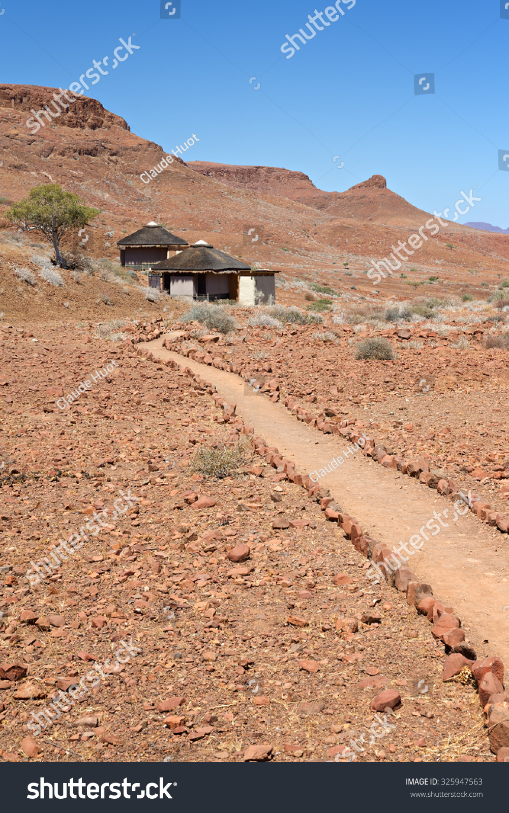 Pathway leading to thatched units in the desertic region at Damaraland Camp, Namibia