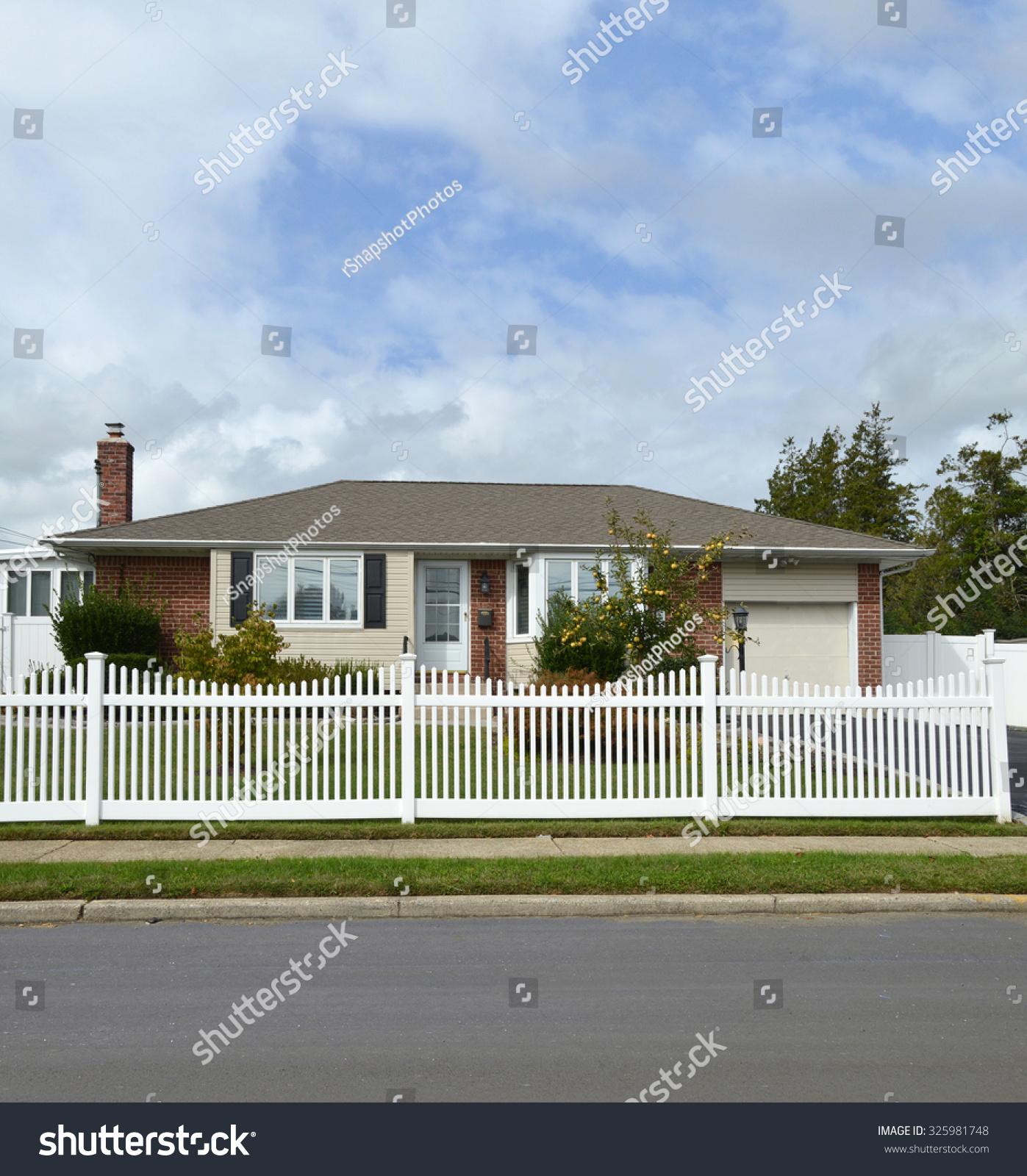 suburban ranch home white picket fence stock photo