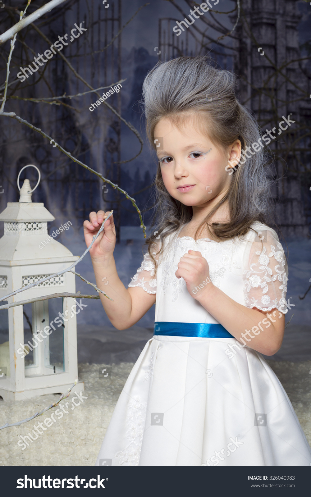Snow princess queen beautiful little girl with a winter makeover in a white