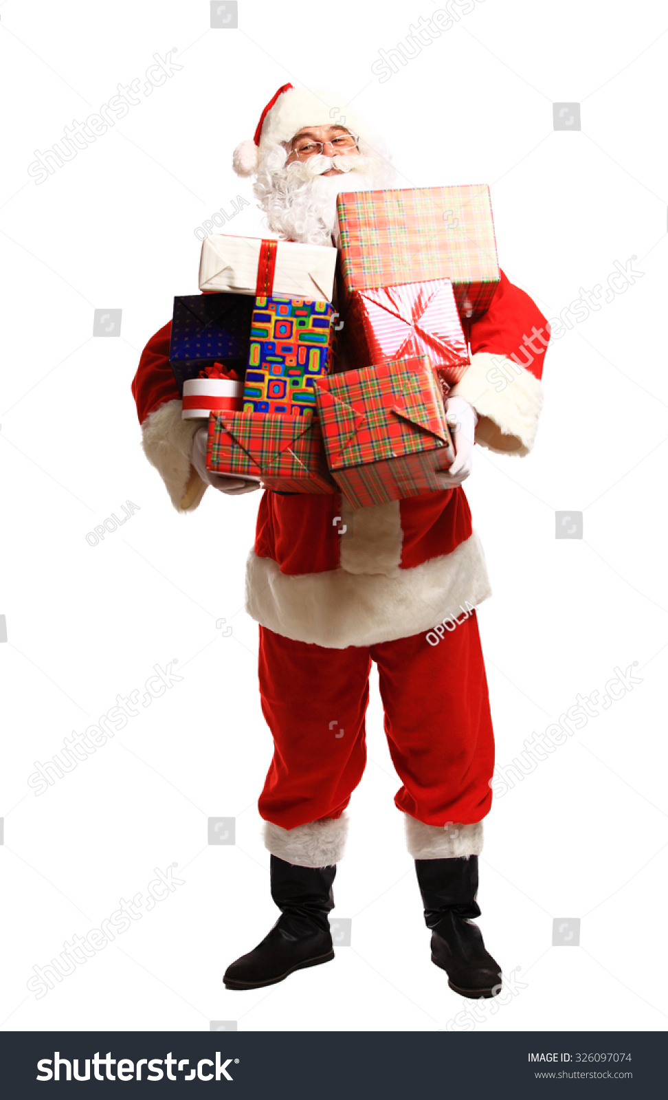 Happy Santa Claus with xmas presents looking at camera
