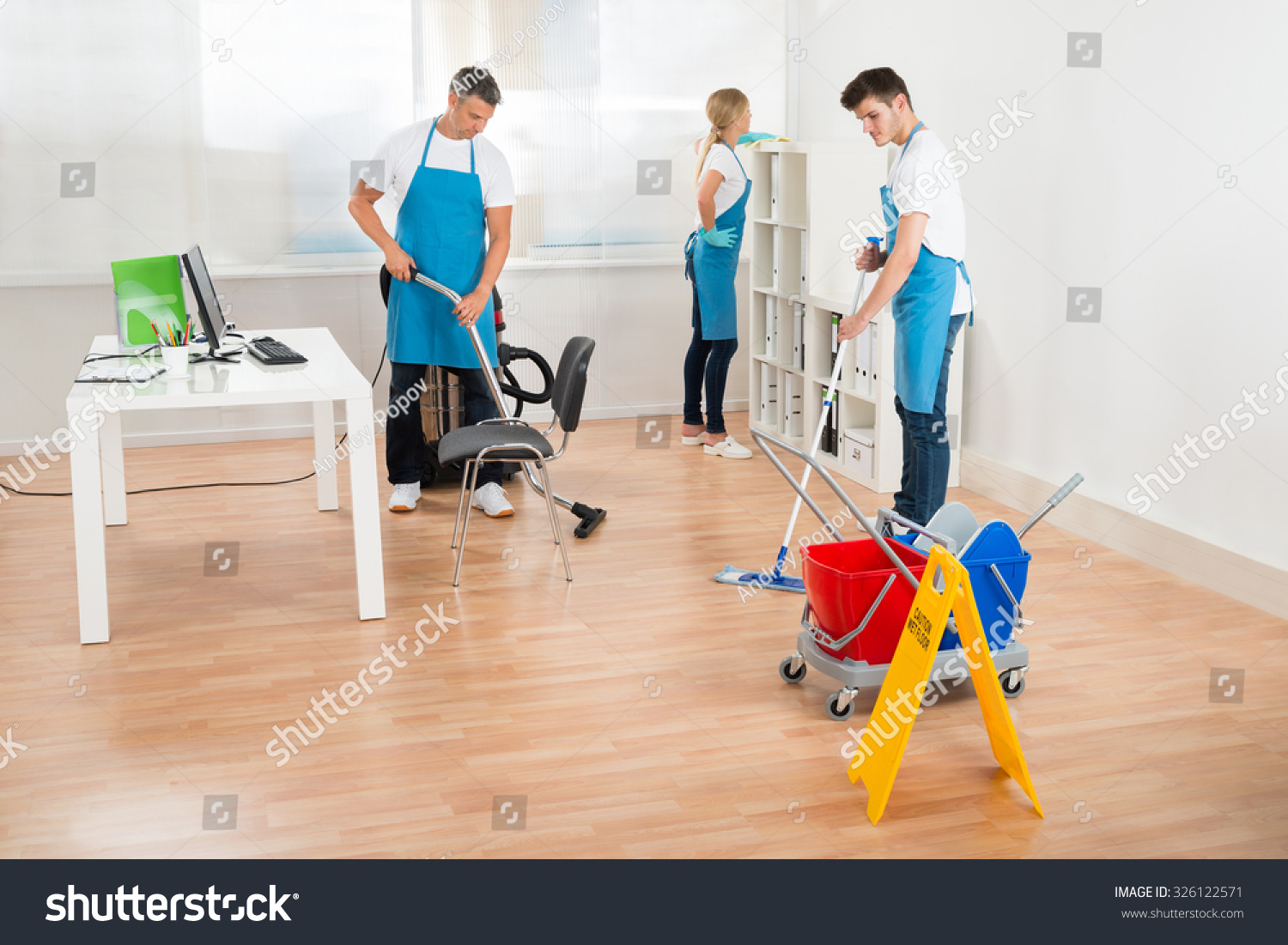 Blue apron office - Group Of Three Janitors In Blue Apron Cleaning Office 326122571