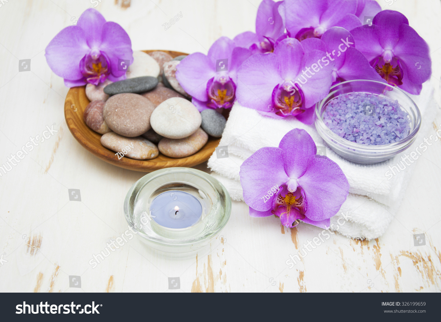 Spa Set Candle Orchid Flowerwhite Towels And Pebble On A Wooden