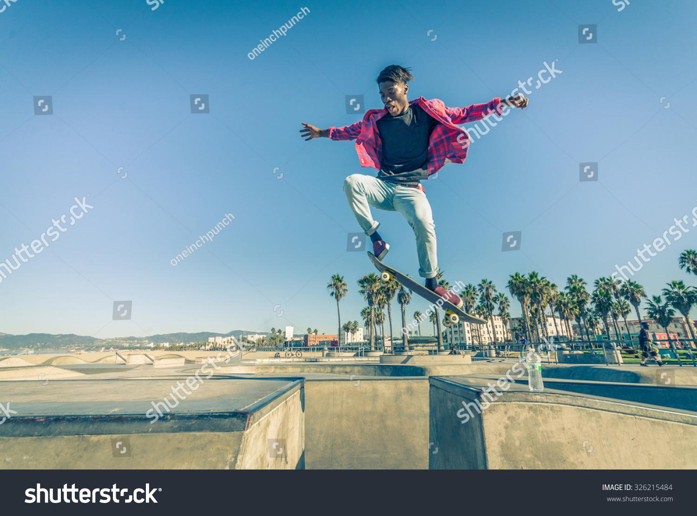 Skateboarder jumping over gap skate park stock photo for Jump the gap