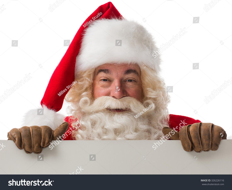Santa claus holding copyspace blank sign stock photo