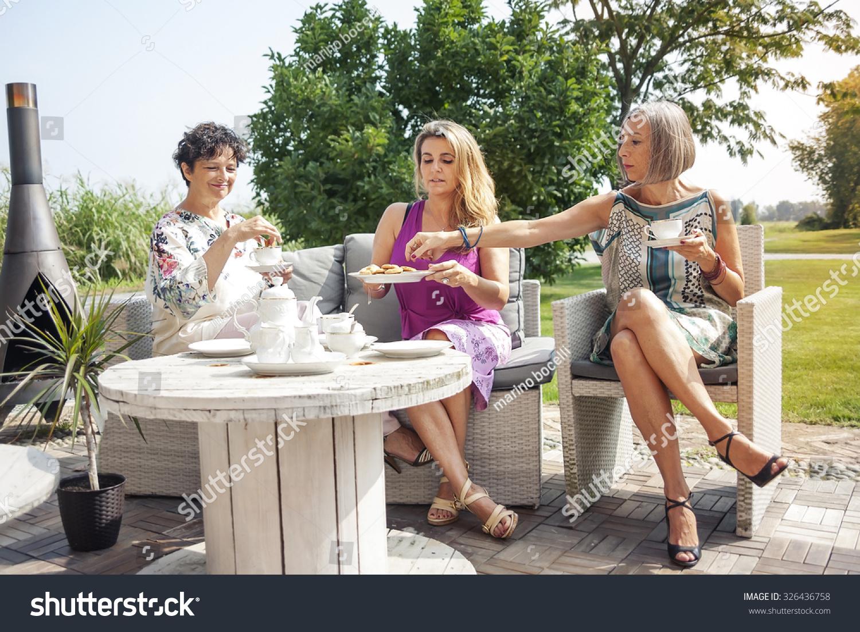 mature beautiful women breakfast outdoor park stock photo 326436758