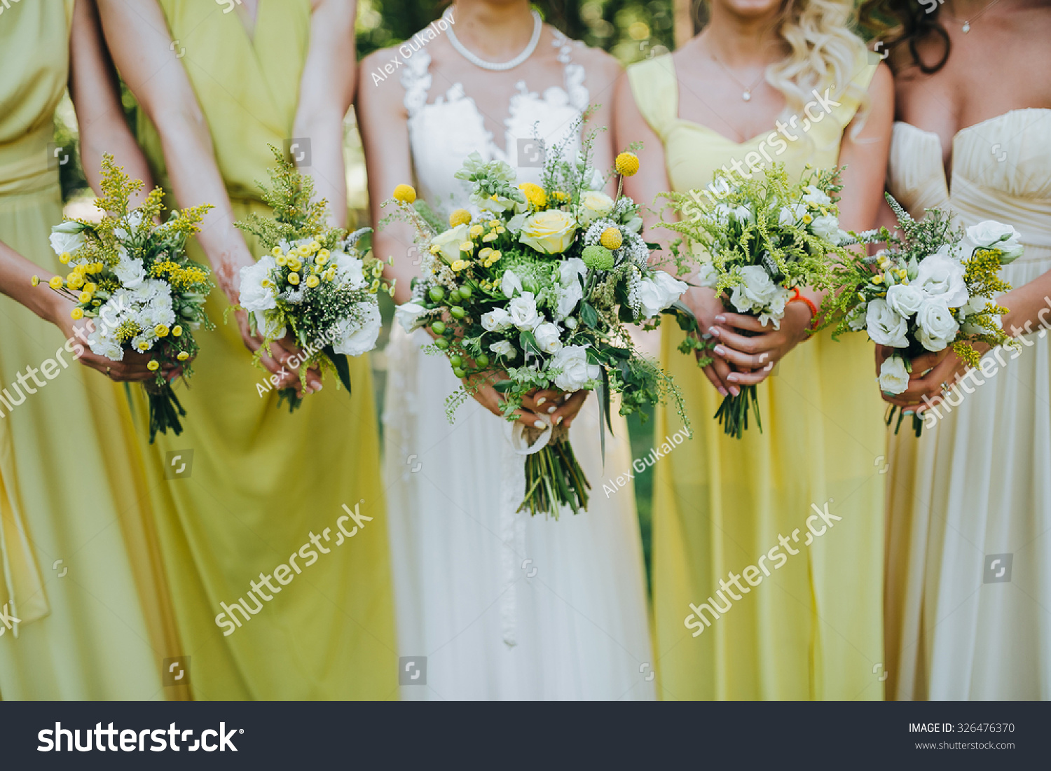 Bride white dress bridesmaids dresses yellow stock photo 326476370 bride in a white dress and bridesmaids dresses are yellow and are holding bouquets of yellow ombrellifo Choice Image