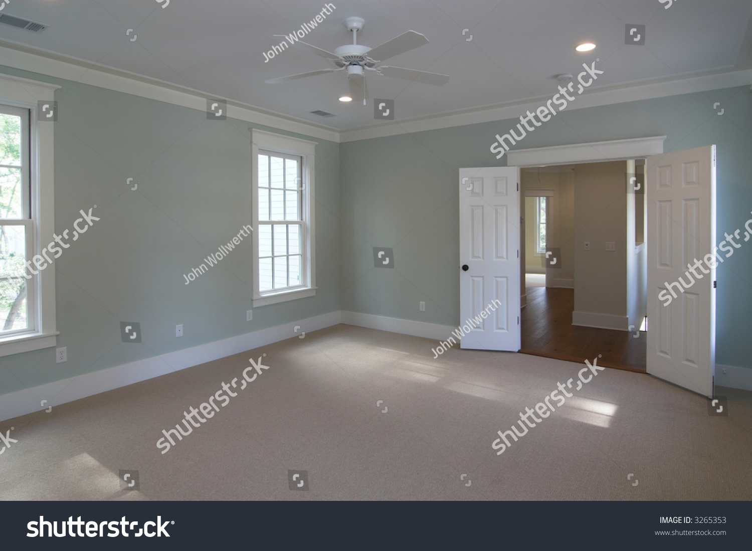 unfurnished bedroom suite with double doors stock photo