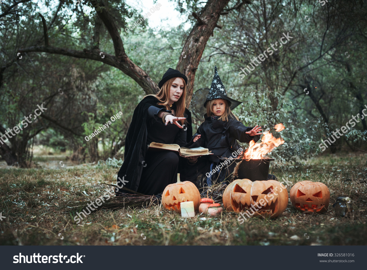 Royalty-free Adult witch and small witch making… #326581016 Stock ...
