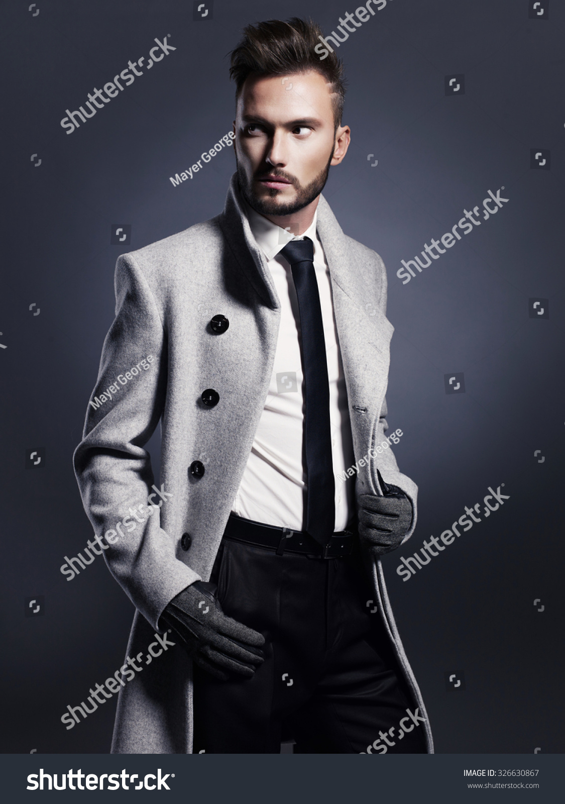 Portrait of handsome stylish man in elegant autumn coat