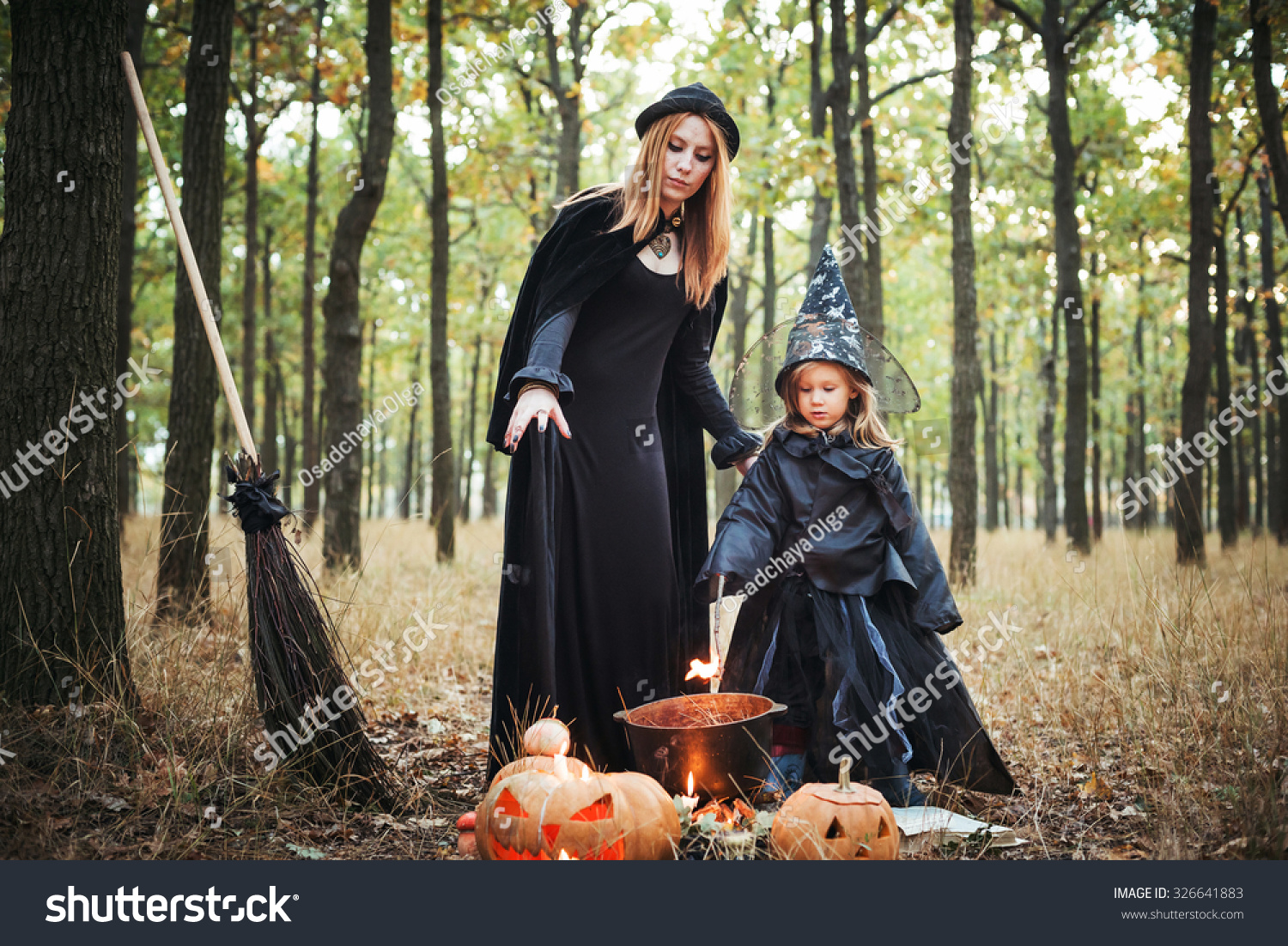 Royalty-free Adult witch and small witch making… #326641883 Stock ...
