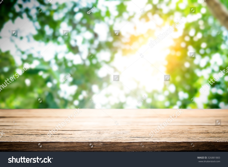 Empty Wooden Table Platform Over Nature Bokeh Garden