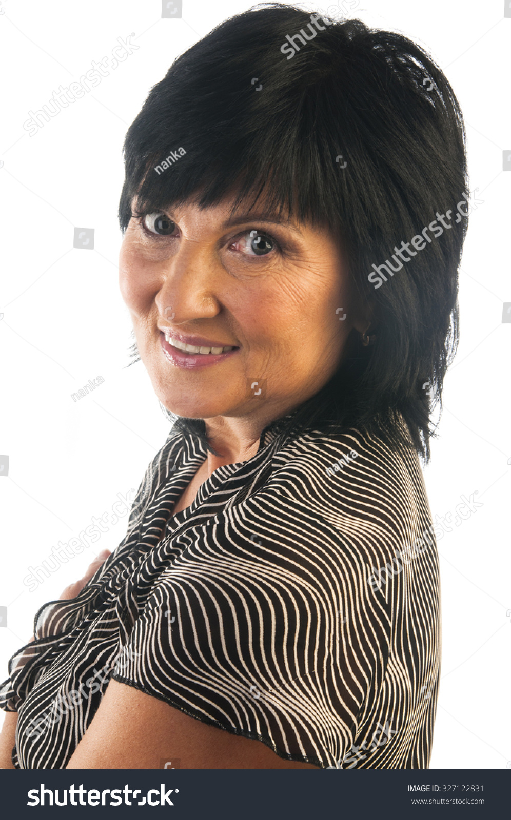 studioportrait beautiful mature woman looking camera stock photo
