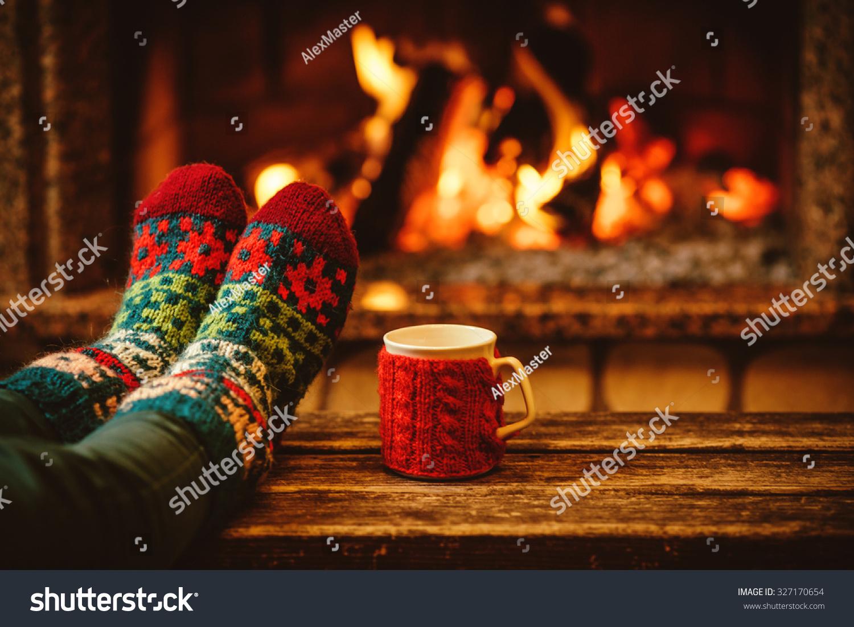 feet woollen socks by christmas fireplace stock photo 327170654