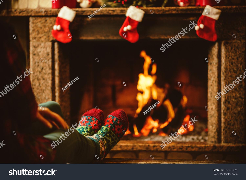 feet woollen socks by fireplace woman stock photo 327170675