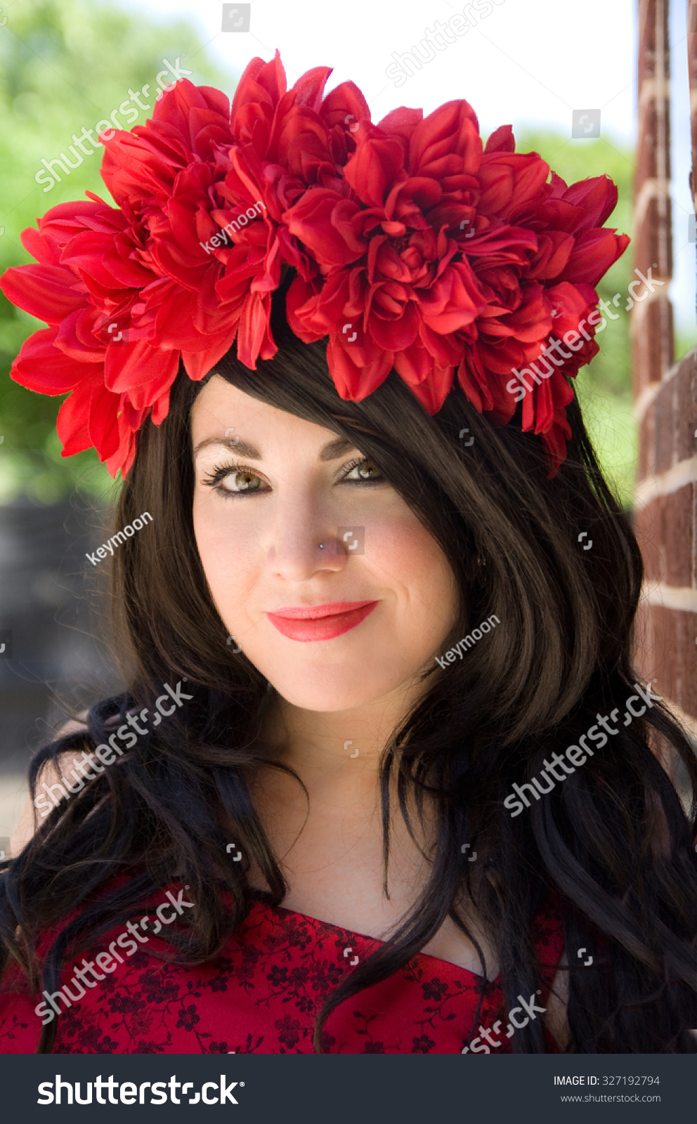 Beautiful woman red flower crown red stock photo royalty free beautiful woman in red flower crown and red lipstick izmirmasajfo