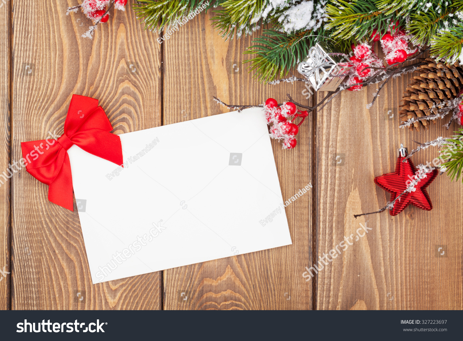 Christmas Tree Branch With Snow And Blank Greeting Card On Wooden