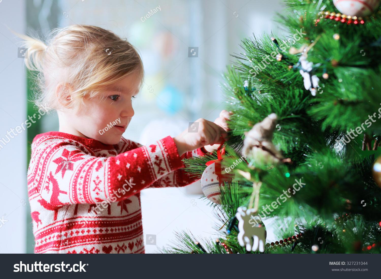 Little Girl Decorating Christmas Tree Toys Stock Photo