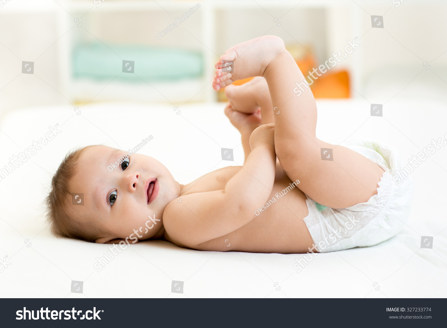 cute baby child little boy lying stock photo (100% legal protection