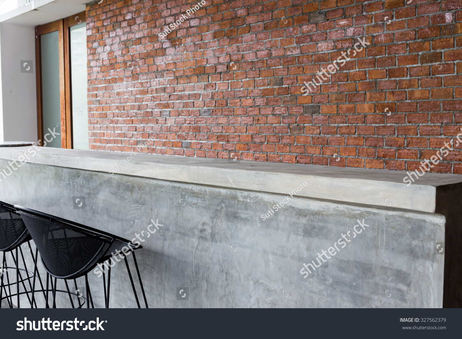 Design of interior counter bar made from cement with iron seat bar stool and brick wall - Wall bar counter ...