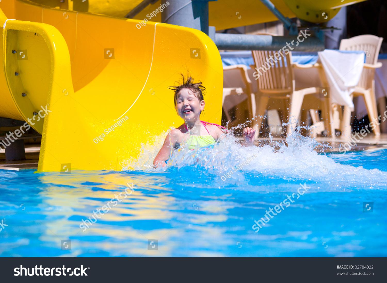 Girl sliding pool during turkey vacations stock photo - Swimming pool girl christmas vacation ...
