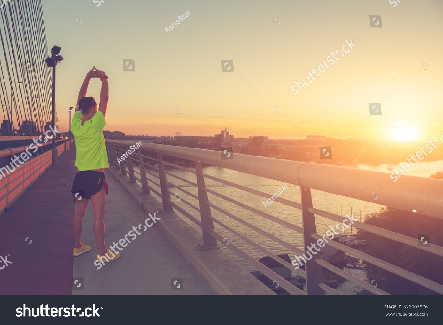 Stretching after jogging on a bridge