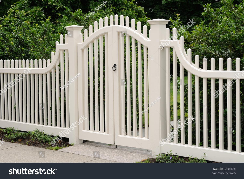 Elegant wooden gate fence on house stock photo
