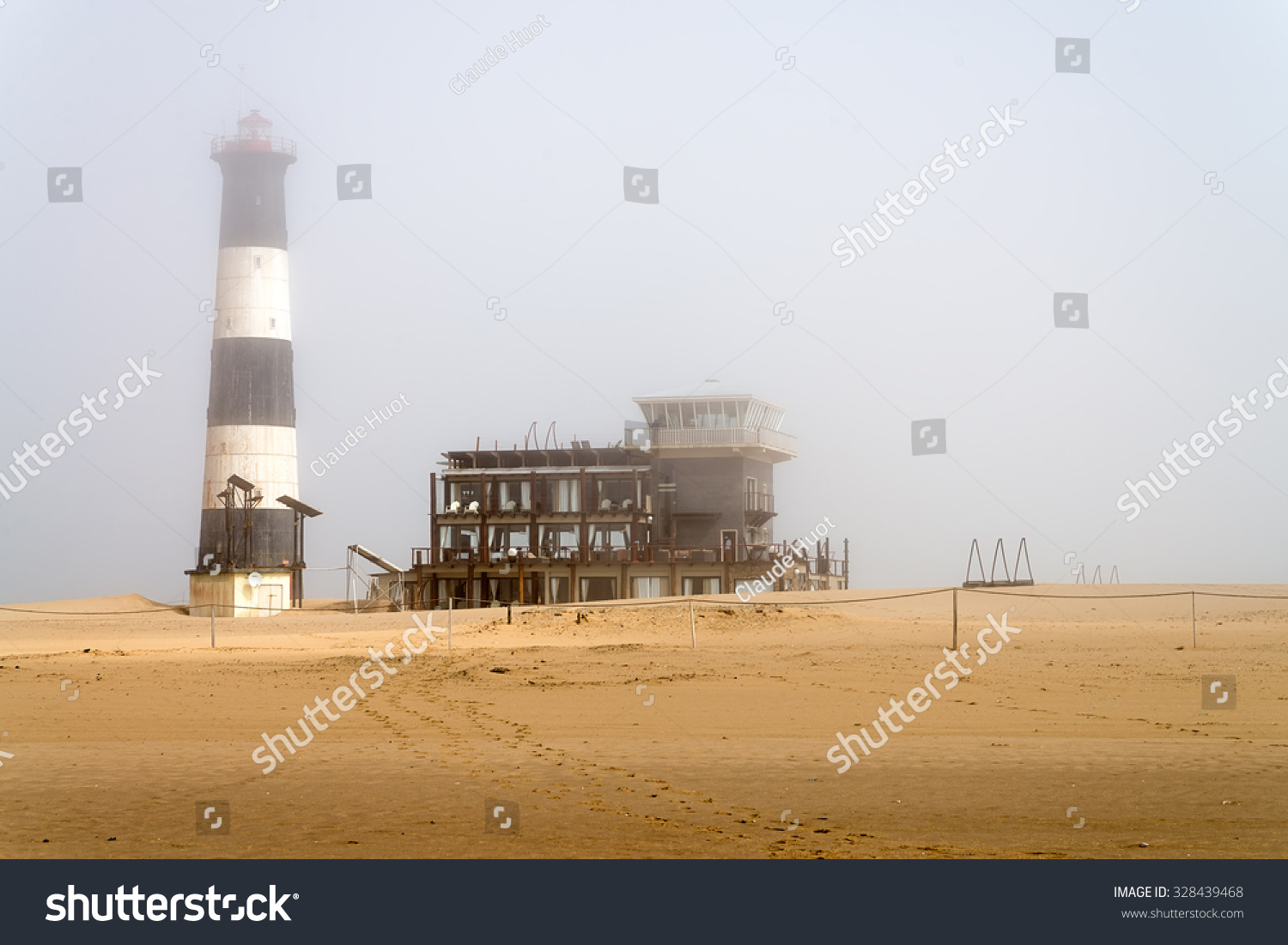 WALVIS BAY, NAMIBIA - SEPTEMBER 3, 2015: Early morning view of Pelican Point Lodge and Lighthouse in the fog. It is situated on a remote peninsula on the Atlantic Ocean near the town of Walvis Bay.