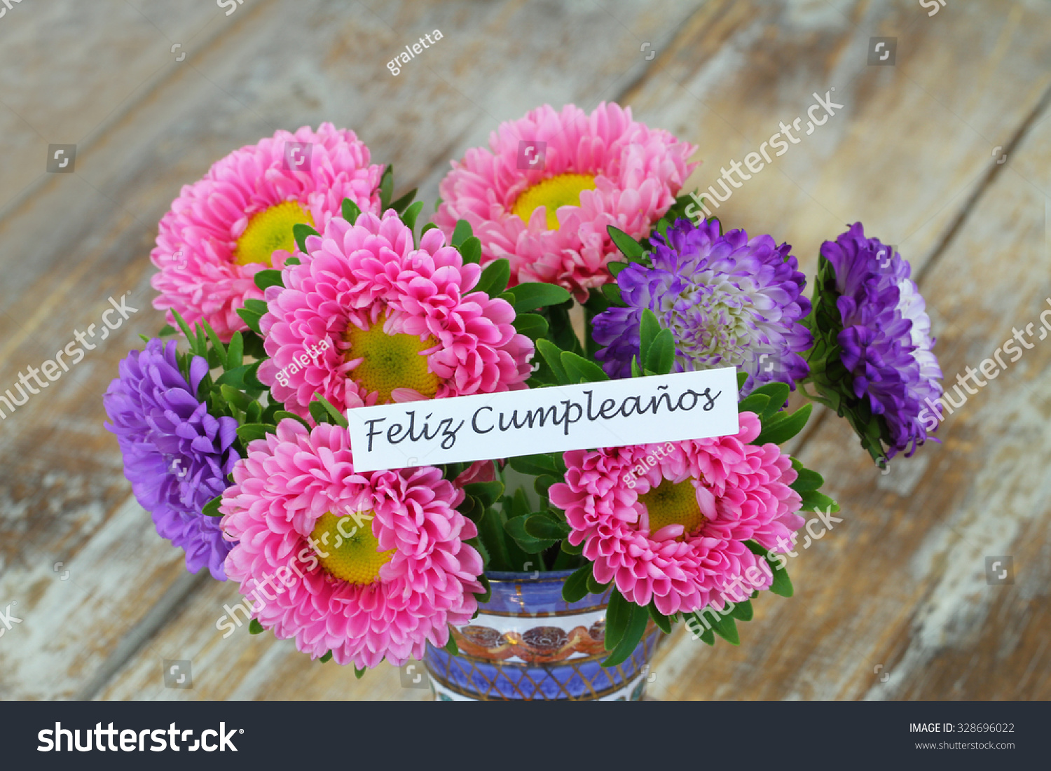 Feliz cumpleanos which means happy birthday stock photo edit now feliz cumpleanos which means happy birthday in spanish card with colorful daisy flower bouquet izmirmasajfo