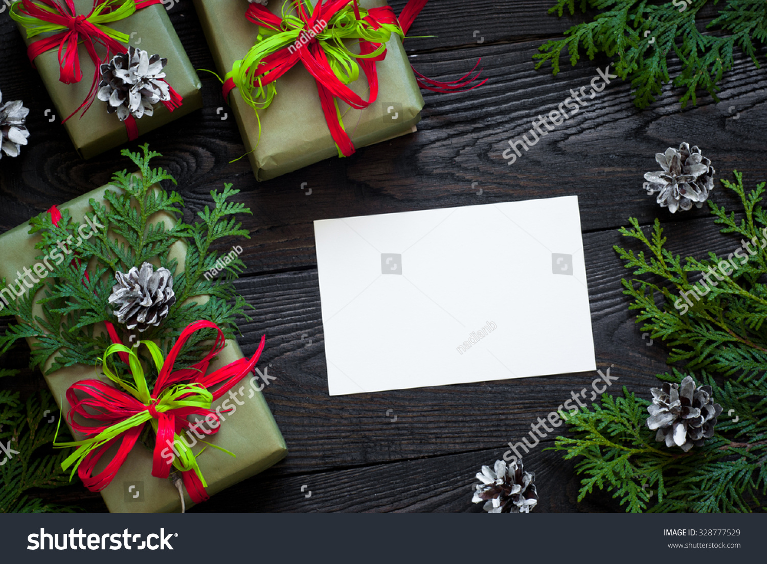 Several Boxes Of Gifts Wrapped In Paper And Decorated With Ribbons