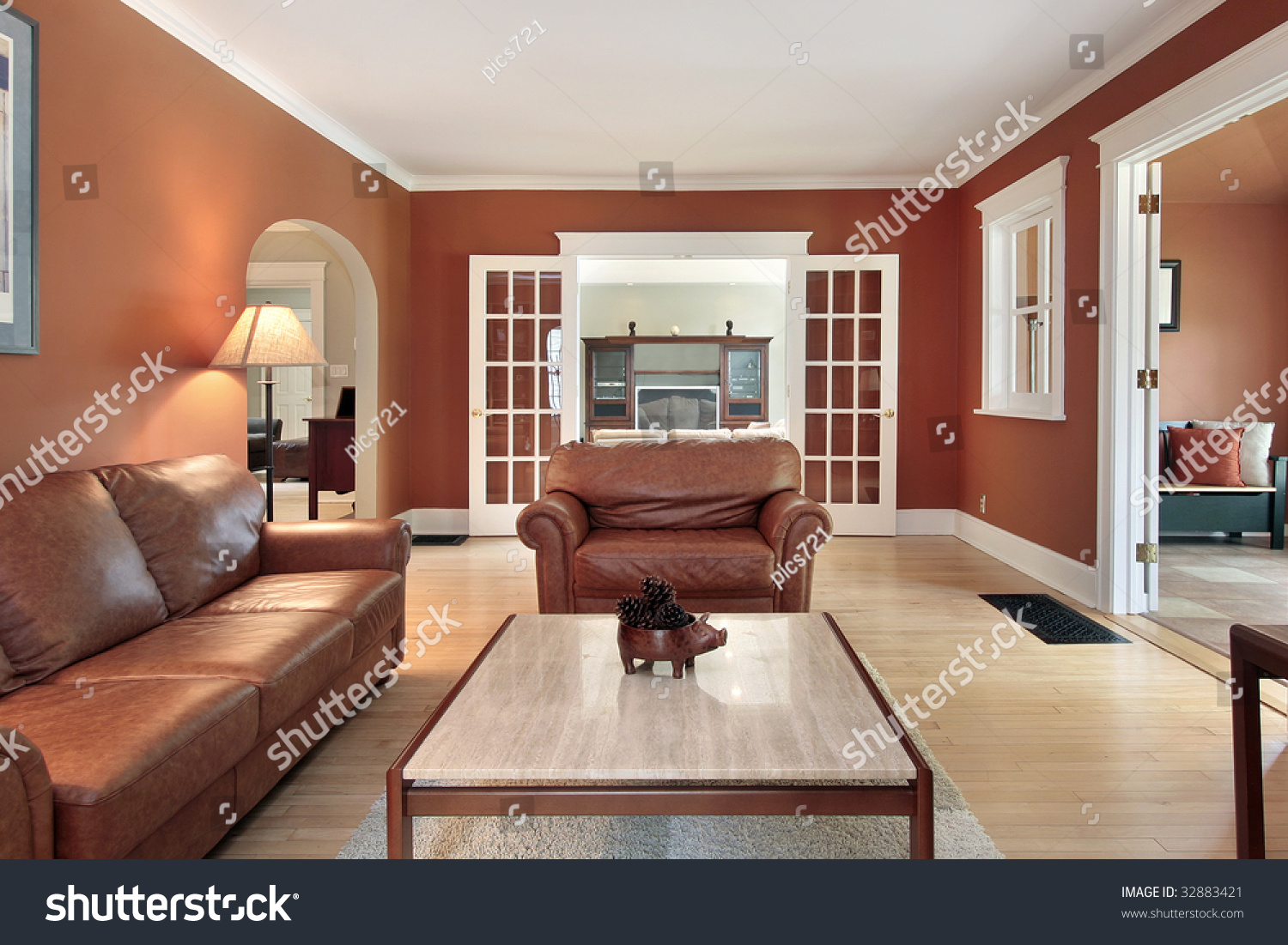 Living Room In Luxury Home With Orange Walls