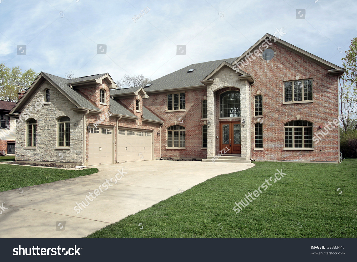 New Construction Brick Home With Stone Entryway Stock