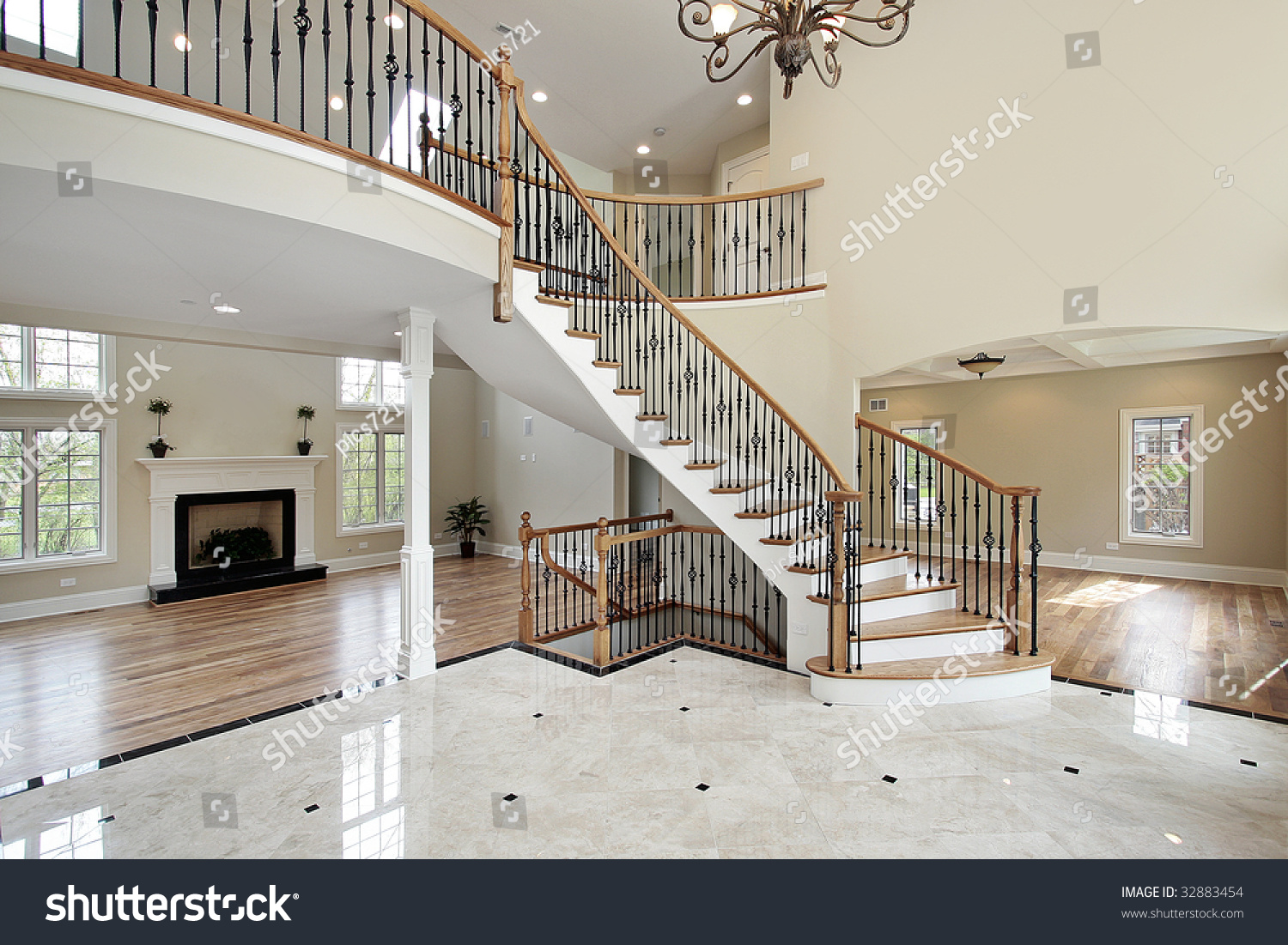 Foyer with curved staircase in luxury home stock photo 32883454 ...