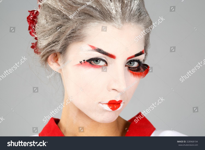 2bdf38e9cf girl in traditional Japanese costume and makeup closeup portrait studio  shot.