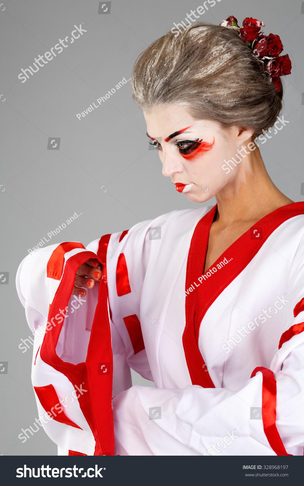 5f19eea359 girl in traditional Japanese costume and makeup looking away studio shot.