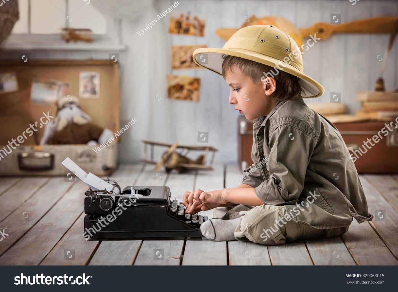 Boy Tourist Typing Letter On Typewriter Stock Photo