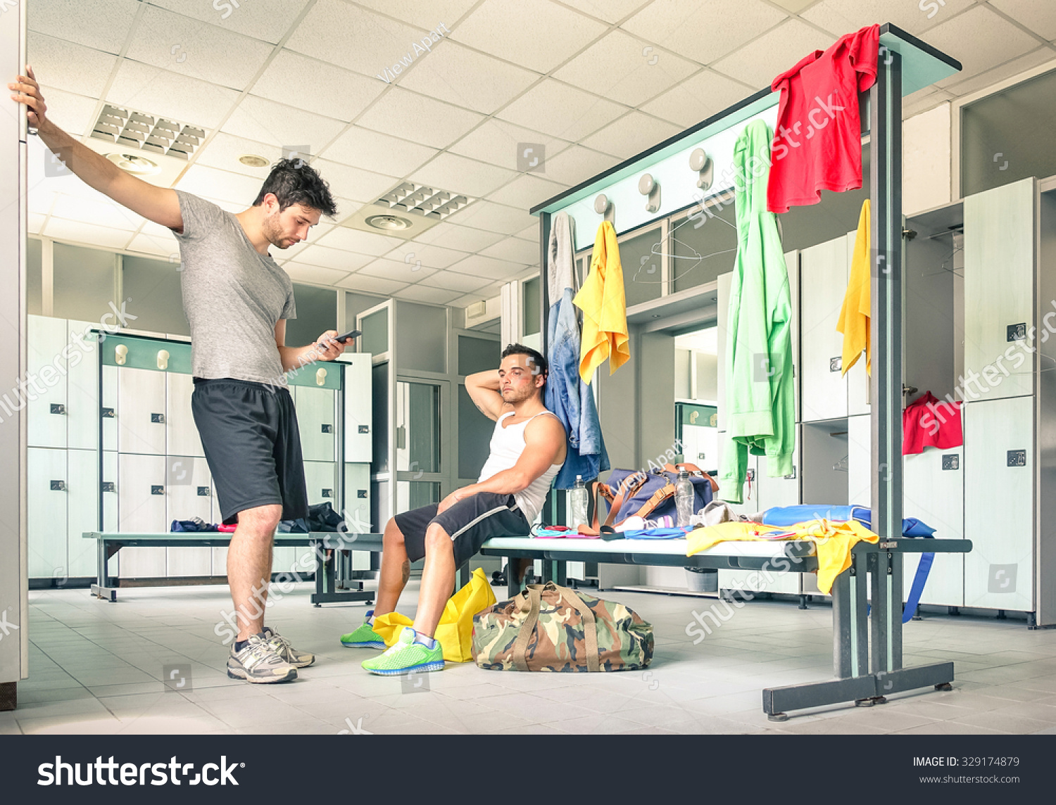 Young people gym dressing room handsome stock photo for Gimnasio fitness studio