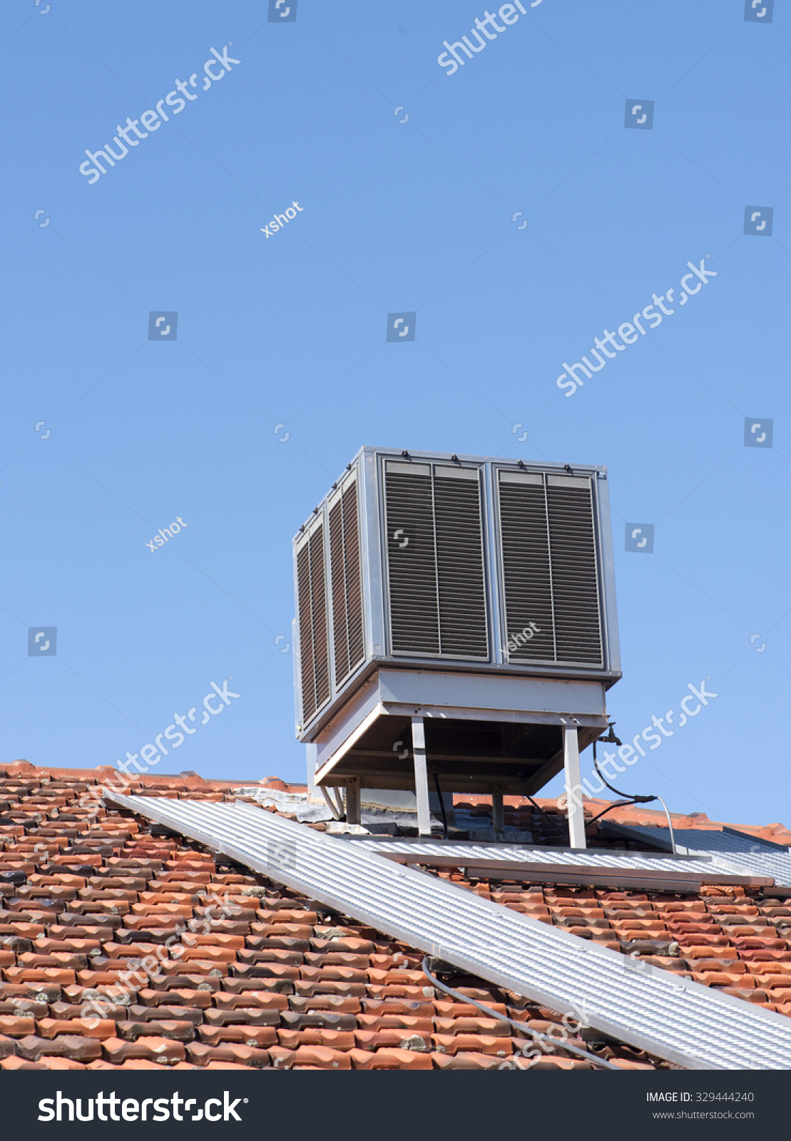 Evaporative Air Conditioner On Top Tiled Stock Photo (Royalty Free ...