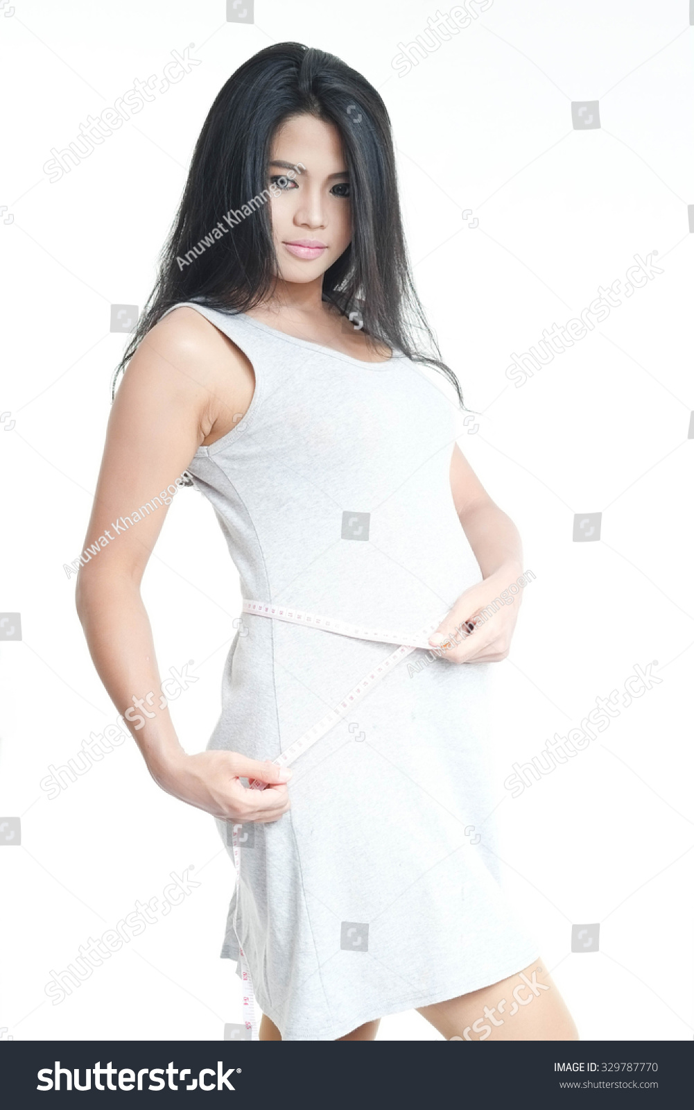 ccbe24a2b69b5 Asian pregnancy woman measurement her belly on white isolate background.