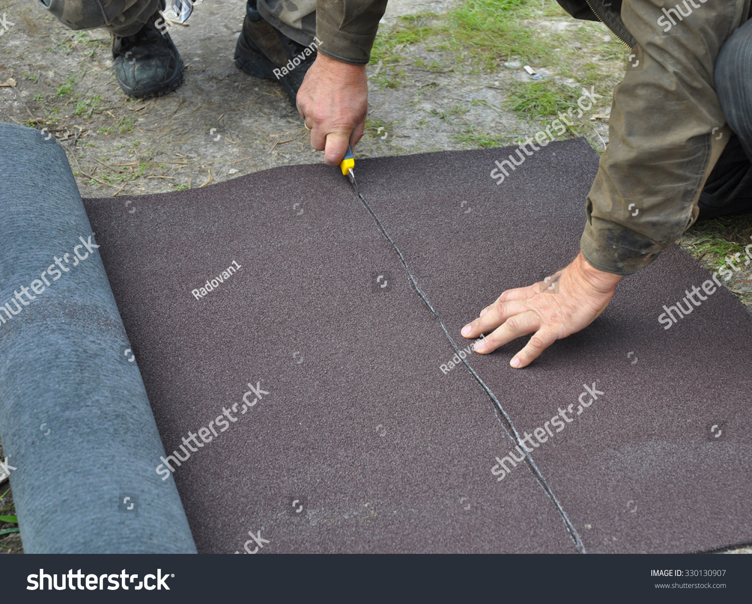 Free Roofer Cutting Roll Roofing Felt Or Bitumen During Works Roofing  Install.
