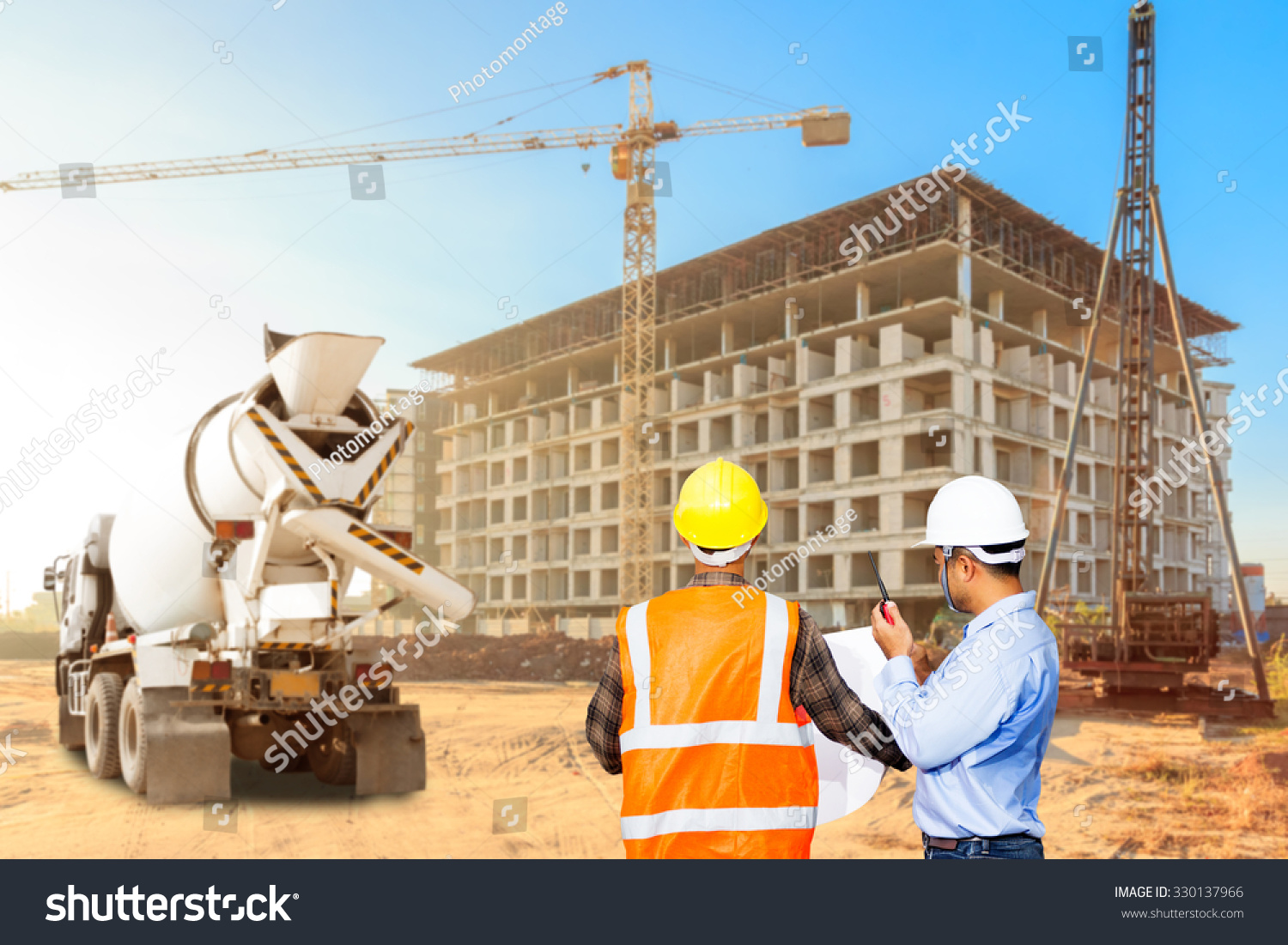Civil engineer and foreman control working at a for Find a builder in your area
