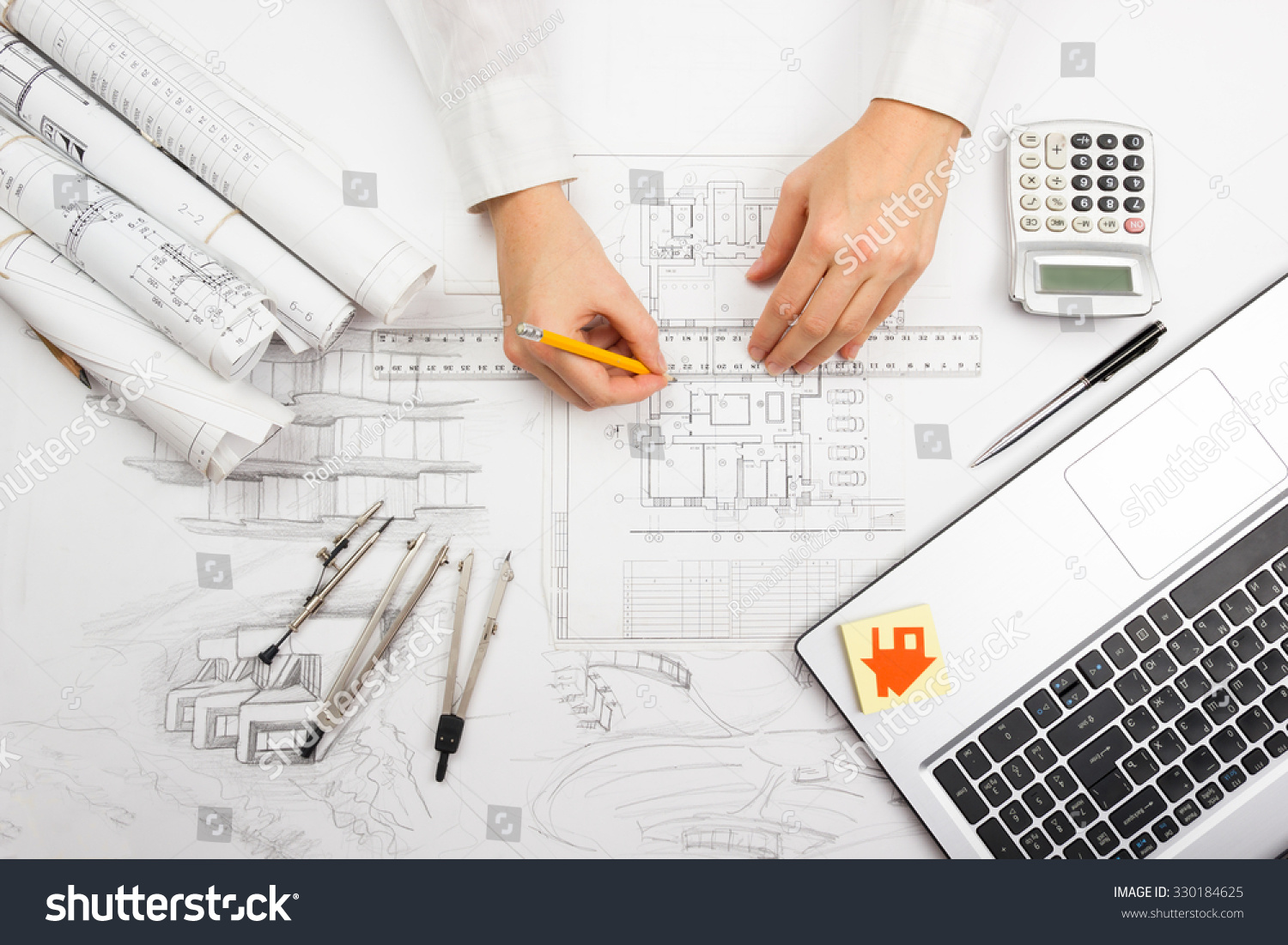 Architect working on blueprint architects workplace imagen de architect working on blueprint architects workplace architectural project blueprints ruler calculator malvernweather