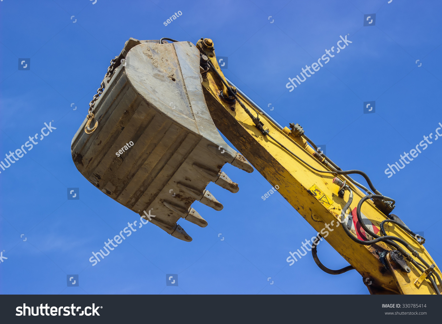 Excavator Hydraulic Arm Project : Hydraulic excavator arm and a bucket at construction site