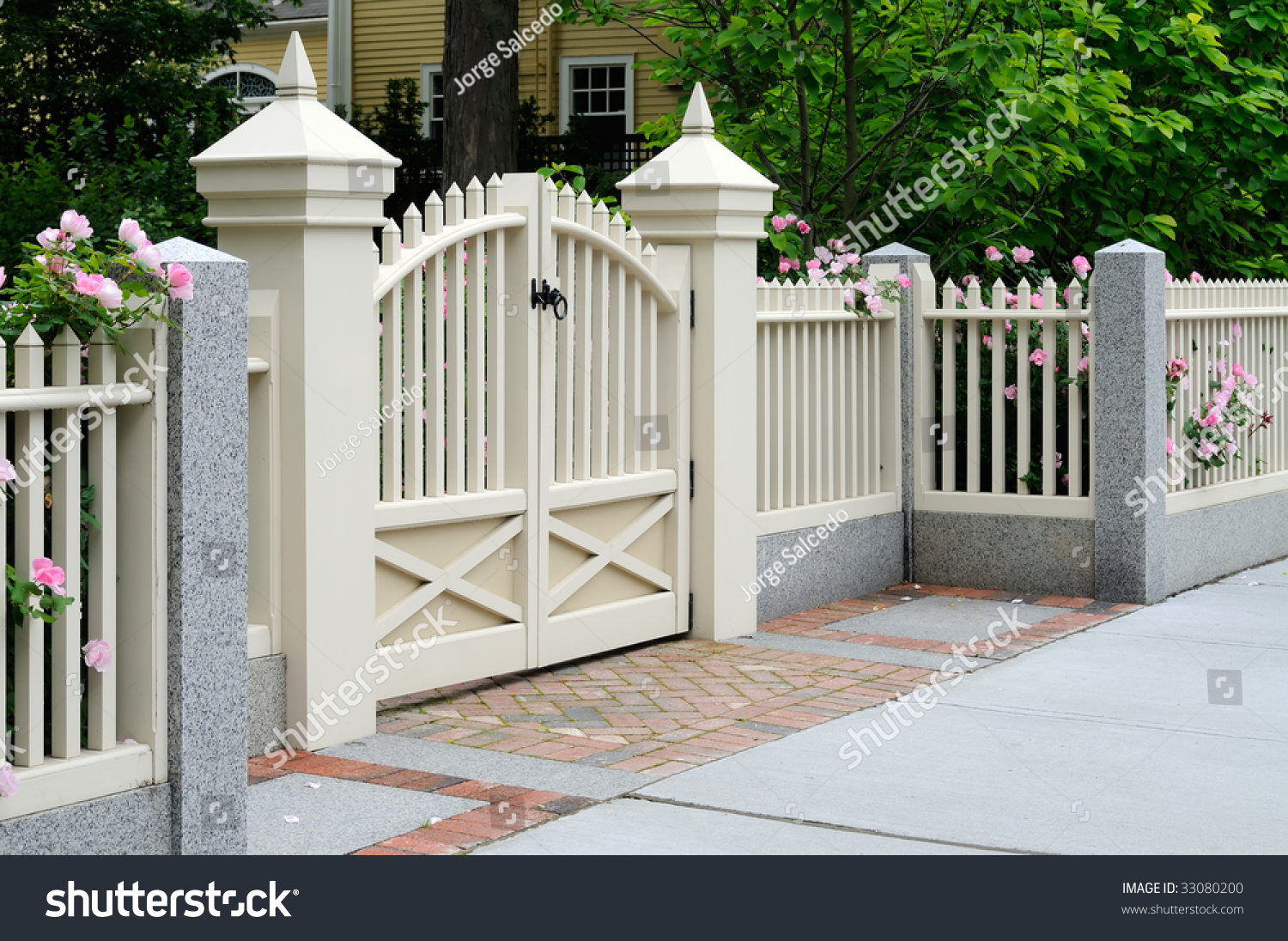 White Gate And Fence With Pink Roses On House Entrance Elegance