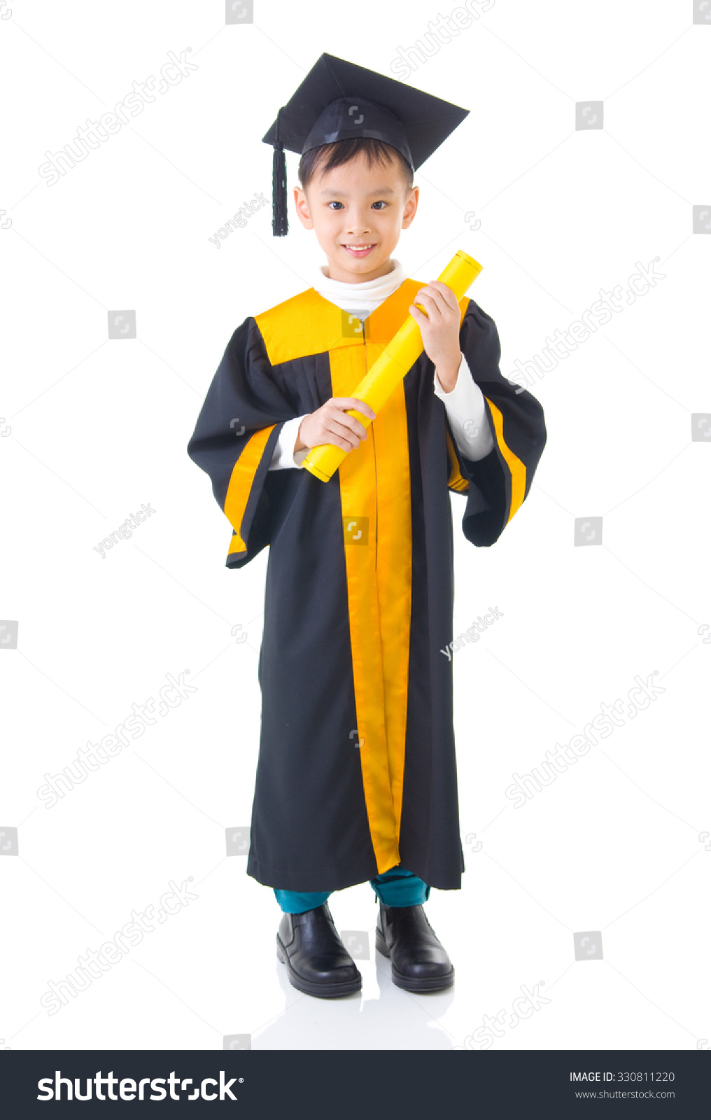 Royalty-free Asian kid in graduation gown #330811220 Stock Photo ...